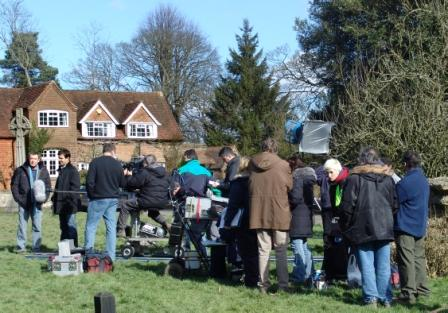 crew of Midsomer Murders on the green, getting ready to shoot after the rain