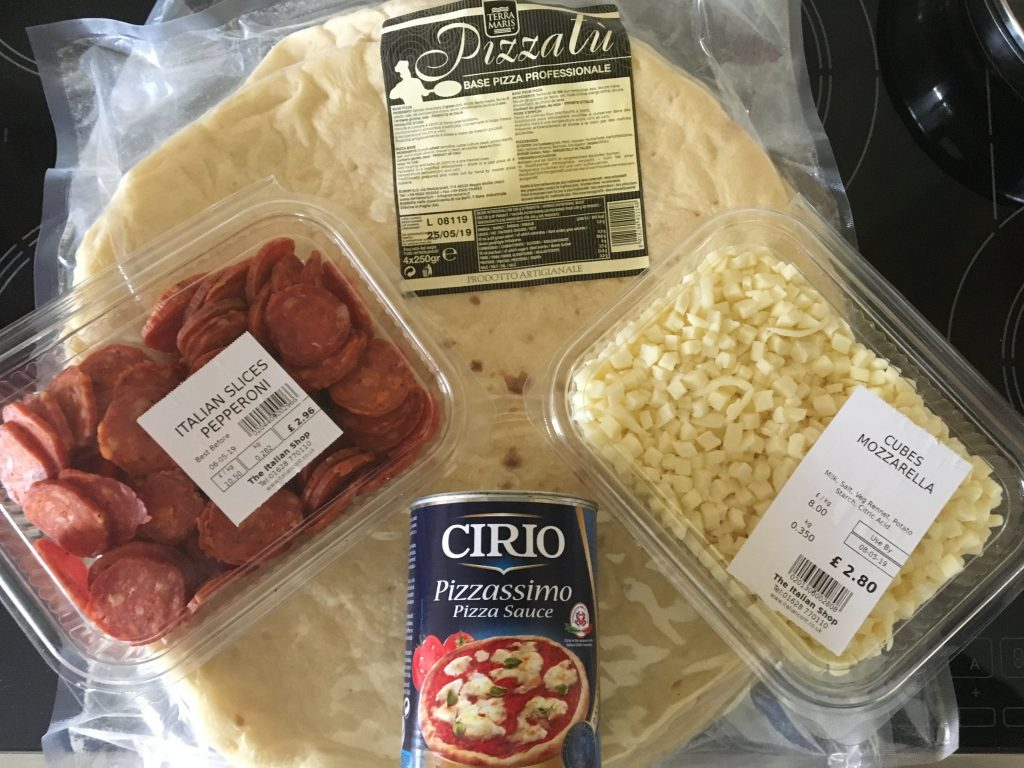 all the ingredients for a pizza