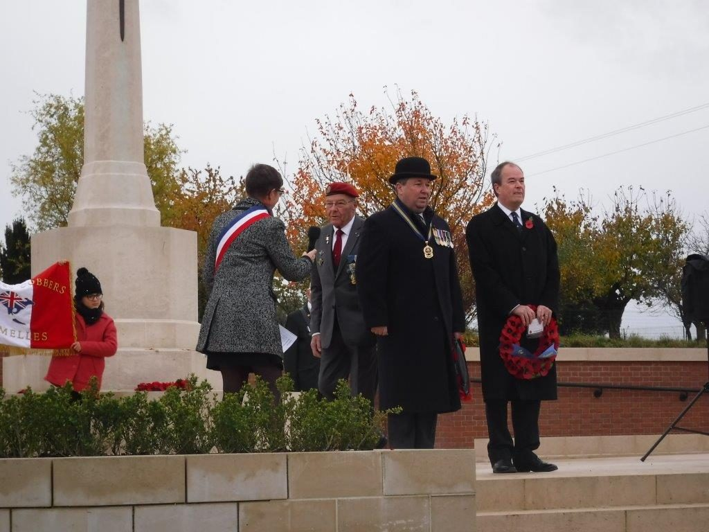 John Ford preparing to lay a wreath at the cenotaph in Fromelles