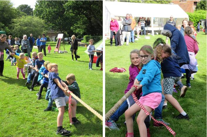 boys vs girls in the tug of war at the Church Fete