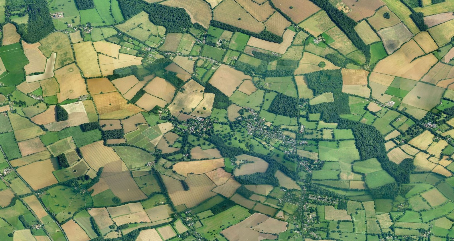 Aerial view of The Parish, a chequerboard of fields and woodland.
