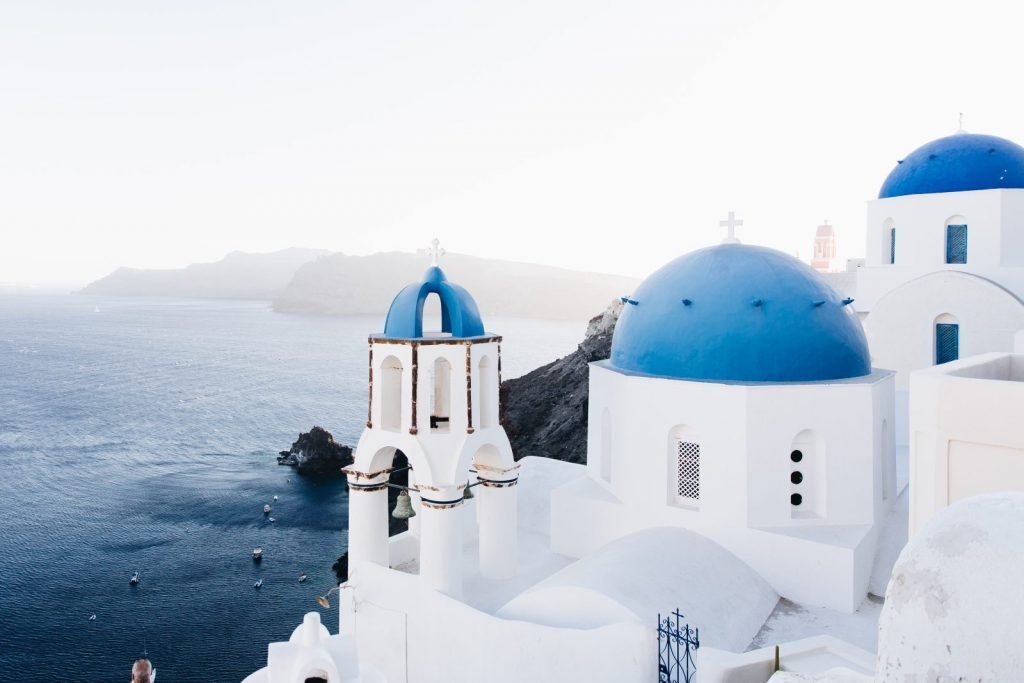 Image of blue roofed churches in Santorini