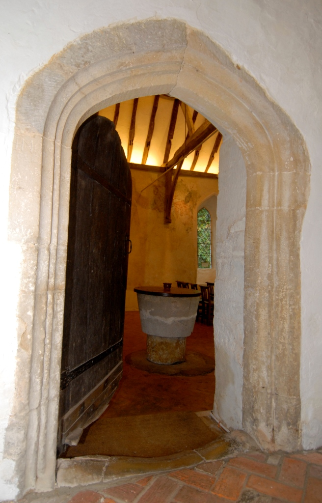 View of the Old Church through the open main door looking onto the font