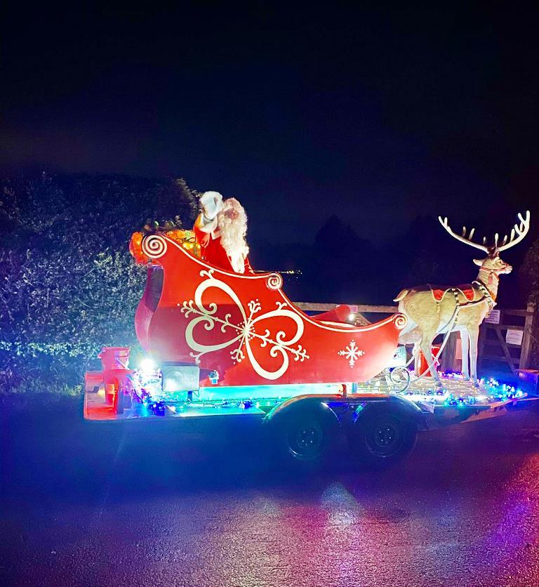 Santa's sleigh, drawn by a reindeer