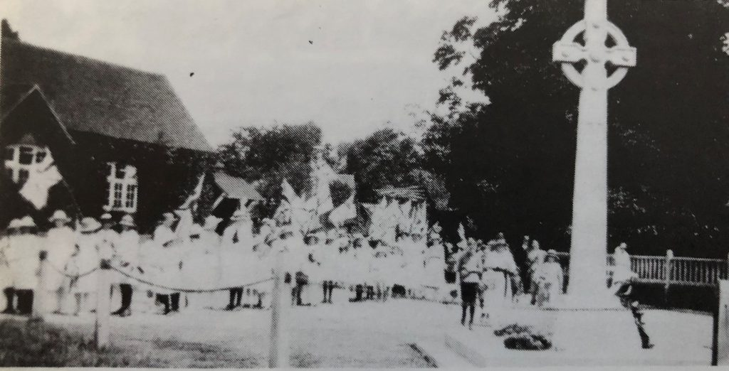 Flags, Banners and Band as the procession passes the War Memorial at The Lee in the early 1920s